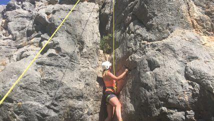 rock climbing during outdoor holiday in spain