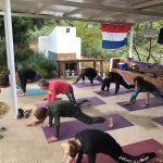 group lesson at active outdoor yoga retreat in Spain